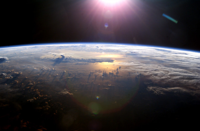 Space Station View of Sun Over Earth From Space